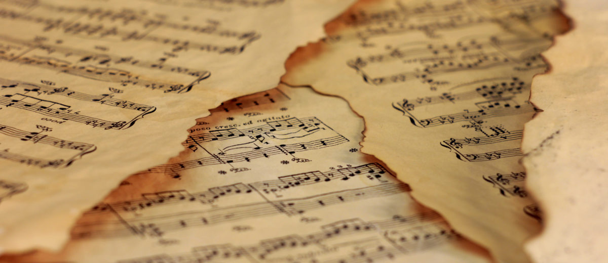 photo of old grunge vintage sheet music papers